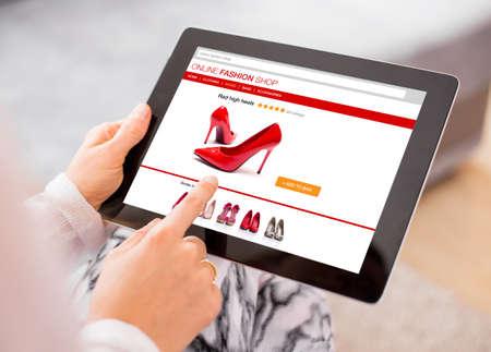 Foto de Woman using digital tablet to shop online - Imagen libre de derechos