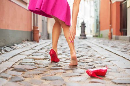 Photo pour Woman injured ankle while wearing high heel shoes - image libre de droit