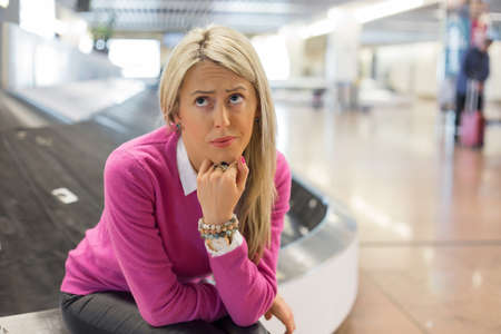 Photo pour Frustrated woman lost her luggage in airport - image libre de droit