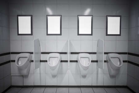 Photo pour Empty advertisement frames in public toilet - image libre de droit