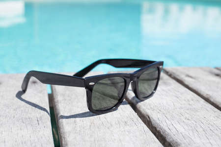 Photo pour Sunglasses by the pool - image libre de droit