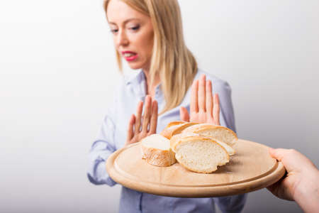 Photo for Woman refusing to eat bread - Royalty Free Image