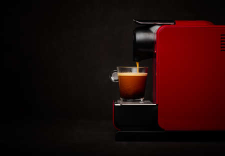 Foto de Coffee machine with cup of coffee - Imagen libre de derechos