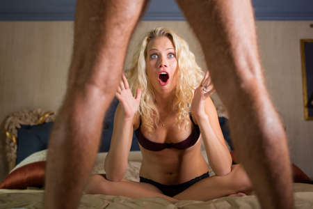 Photo for Woman in shock looking at mans penis - Royalty Free Image
