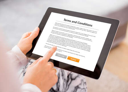 Photo for Person accepting terms and conditions on tablet - Royalty Free Image