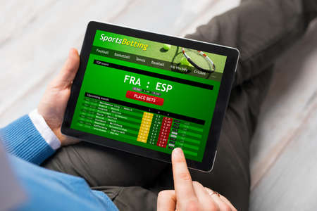 Photo for Man using sports betting app - Royalty Free Image