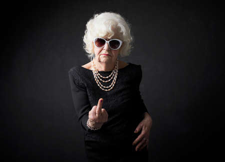 Foto de Grandmother flipping people off - Imagen libre de derechos