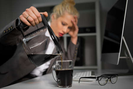 Photo for Woman pouring coffee in cup - Royalty Free Image