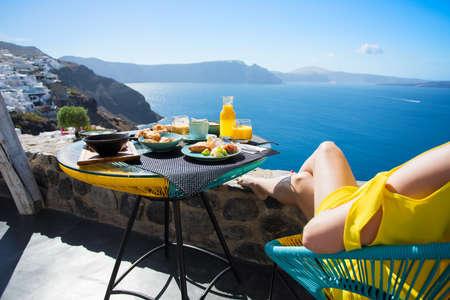 Photo for Woman enjoying breakfast on terrace - Royalty Free Image