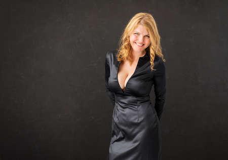 Photo pour Woman in black dress on black background - image libre de droit