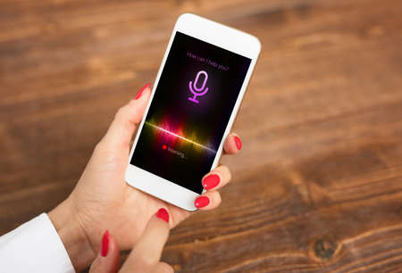 Photo pour Voice assistant concept on mobile phone - image libre de droit