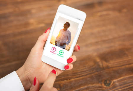 Photo pour Woman using dating app and swiping user photos - image libre de droit