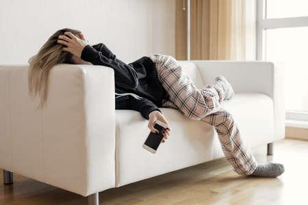 Foto de Apathic lazy woman lying in sofa - Imagen libre de derechos