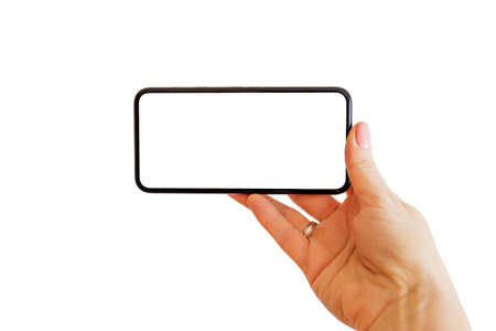Foto de Person using phone with empty white screen. Mobile app mockup. - Imagen libre de derechos