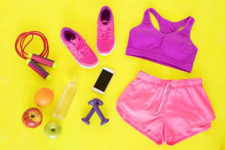 Different workout essentials on yellow floor