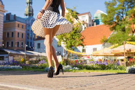 Foto de Woman with beautiful legs wearing skirt and heels - Imagen libre de derechos