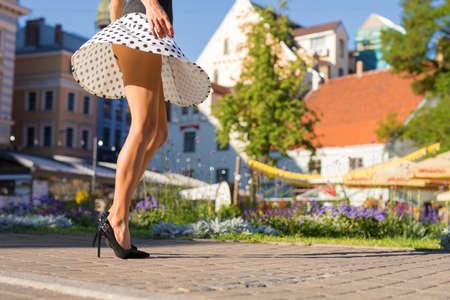 Photo for Woman with slim legs walking in city - Royalty Free Image
