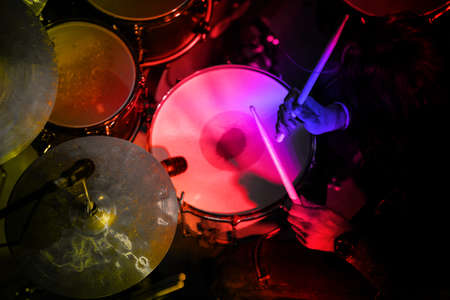 Photo for Drummer in the action. Rock music concert. - Royalty Free Image