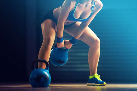 Photo for Fitness woman training by kettlebell. - Royalty Free Image