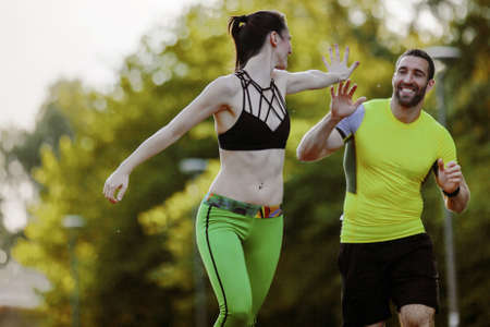 Photo pour Early morning workout. Happy couple running. Living healthy lilfestyle. - image libre de droit