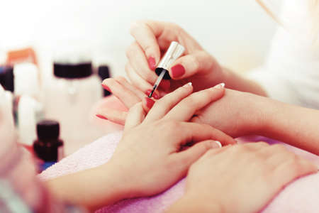 Photo pour Well manicured nails. Female nails receiving manicure. - image libre de droit