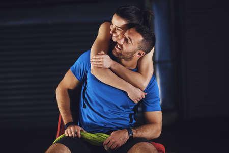 Foto de Young athlete couple is relaxing after training. - Imagen libre de derechos