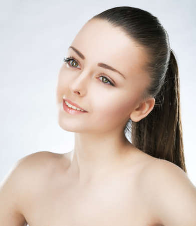 Beauty portrait of lovely girl fashion model with natural soft make-up and clean healthy skin
