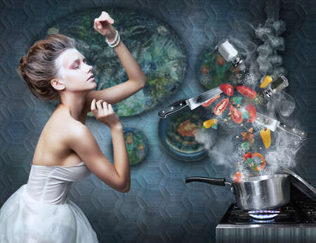 Beautiful emotional woman in kitchen interior cooking  Art  Creative concept