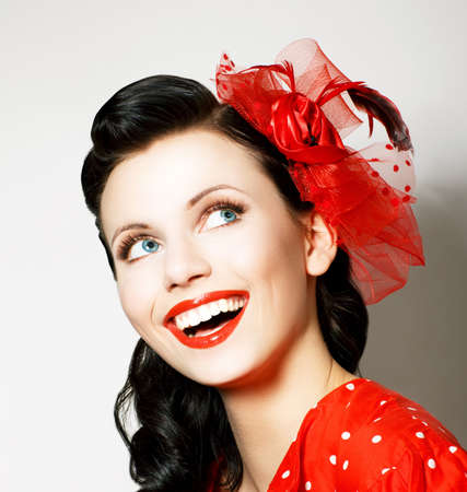 Photo for Vitality  Cheerful Young Woman with Red Bow enjoying  Pleasure - Royalty Free Image