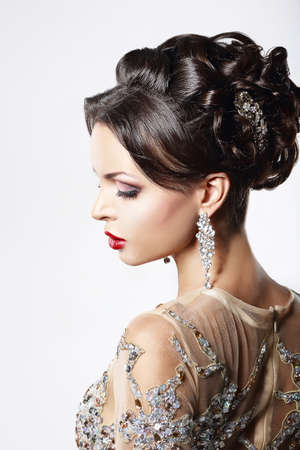 Photo pour Profile of Classy Brown Hair Lady with Jewelry and Festive Hairstyle - image libre de droit
