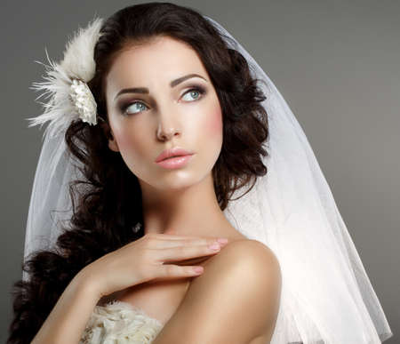 Photo for Wedding  Young Gentle Quiet Bride in Classic White Veil Looking Away - Royalty Free Image