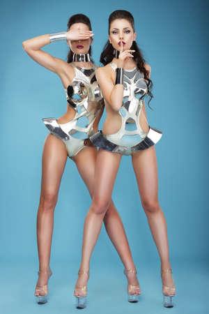 Photo pour Extravagance  Two Heeled Women in Futuristic Clubwear  Hangouts - image libre de droit