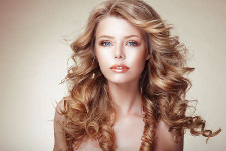 Photo for Portrait of Woman with Beautiful Flowing Bronzed Frizzy Hair - Royalty Free Image