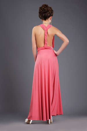 Photo for Rear View of Shapely Lady in Evening Gown - Royalty Free Image