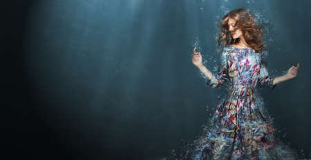 Photo for Immersion. Woman in Deep  Blue Sea. Fantasy - Royalty Free Image