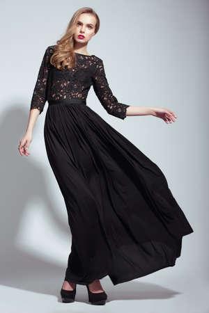 Photo pour Elegance. Young Fashion Model in Black Dress - image libre de droit