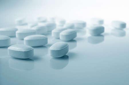 Foto de Pharmacy theme,  white  medicine tablets antibiotic pills. - Imagen libre de derechos