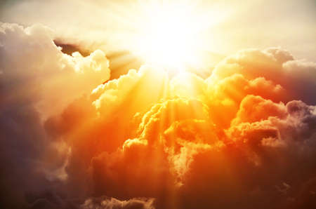 Foto de The bright rays of the sun are shining from saturated clouds - Imagen libre de derechos