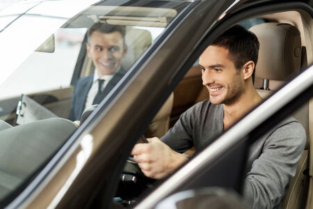 Photo pour First test drive. Handsome young man ready to make first test drive - image libre de droit