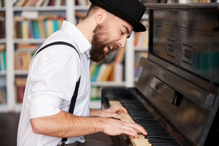 Photo for He got creative soul. Handsome young bearded men playing piano and singing - Royalty Free Image