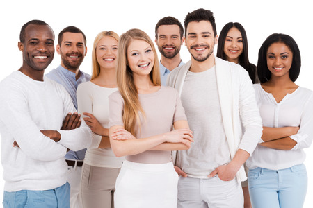 Photo pour Positive professional team. Group of positive and diverse people in smart casual wear looking at camera and smiling while standing against white background - image libre de droit