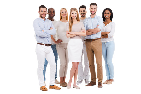 Photo pour Proud to be a team. Full length of multi-ethnic group of people in smart casual wear looking at camera and smiling while standing against white background - image libre de droit