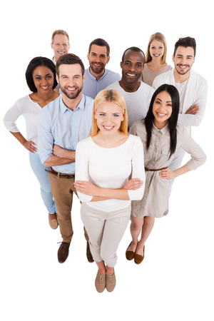 Foto de Proudly successful. Top view of positive diverse group of people in smart casual wear looking at camera and smiling while standing close to each other - Imagen libre de derechos