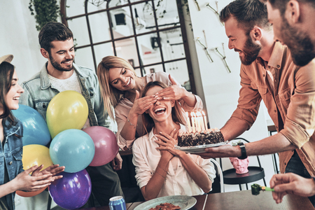Photo pour Birthday girl. Group of happy people celebrating birthday among friends and smiling while having a party - image libre de droit