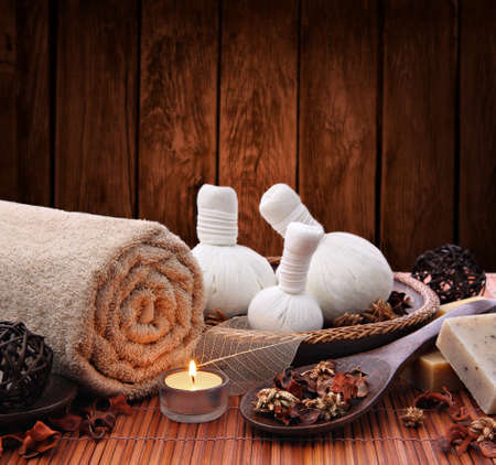 Candlelight spa setting with thai herbal compress massage stamps