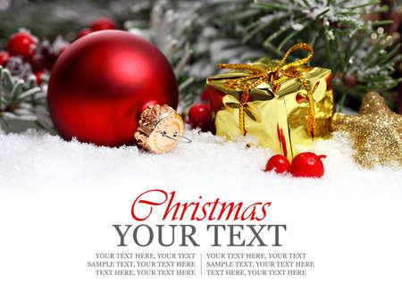 Photo pour Christmas border with ornament, golden present and snow - image libre de droit