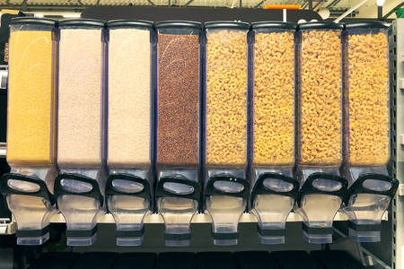 Photo for millet, rice, buckwheat, pasta in the containers dispensers - Royalty Free Image