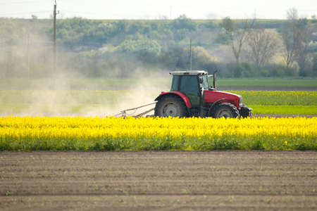 Photo for Tractor on the fields - Royalty Free Image