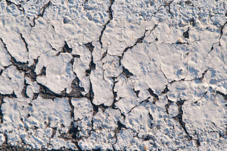 Photo for Old road asphalt texture with relics of white paint - Royalty Free Image