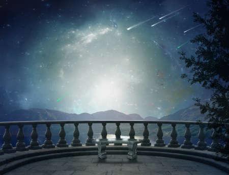 Foto de Fantastic balcony in a brilliant night and landscape in the back - Imagen libre de derechos